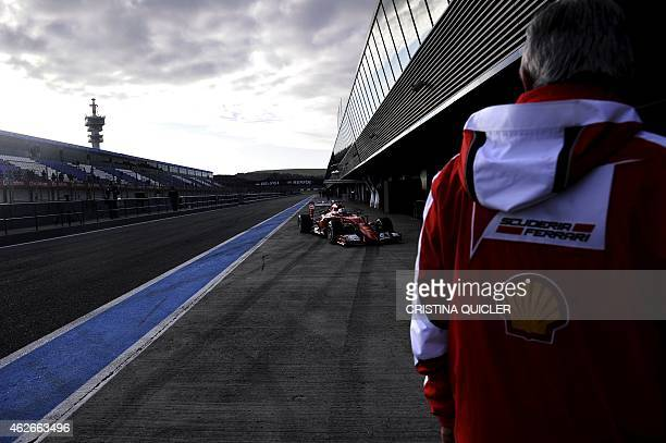 F1 Ferrari Team's Germany Sebastian Vettel arrives into the pit during the second day of the Formula One preseason tests at Jerez racetrack in Jerez...