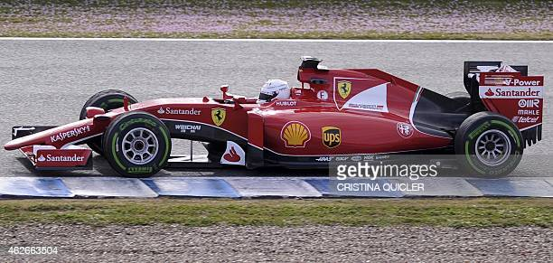 F1 Ferrari Team's Germany Sebastian Vettel drives on the second day of the Formula One preseason tests at Jerez racetrack in Jerez on February 2 2015...