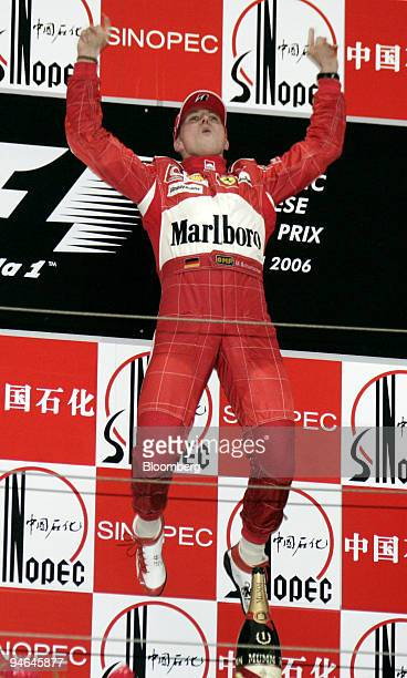 Ferrari team's Michael Schumacher of Germany makes his famous victory jump after winning the Formula 1 Grand Prix of Shanghai in China Sunday October...
