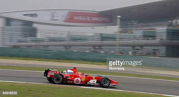 Ferrari team's Michael Schumacher of Germany passes the Paddock building during the first practise day of the Formula 1 Grand Prix of China in...