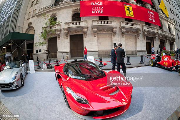 Ferrari vehicles are displayed outside the New York Stock Exchange on Wednesday, October 21, 2015 for the initial public offering of the luxury...