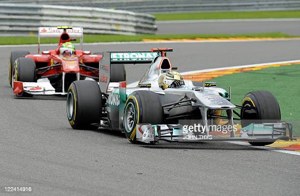 Ferrari's Brazilian driver Felipe Massa and Mercedes' German driver Michael Schumacher drive at the SpaFrancorchamps circuit on August 28 2011 in Spa...