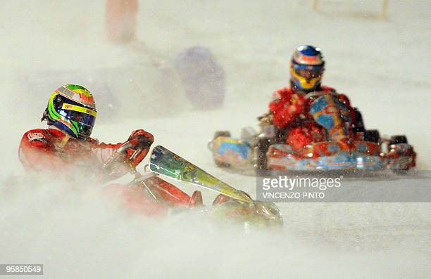 Ferrari's drivers Brazilian Felipe Massa compete with new teammate Spanish Fernando Alonso during an ice kart race on January 15 2010 during the...