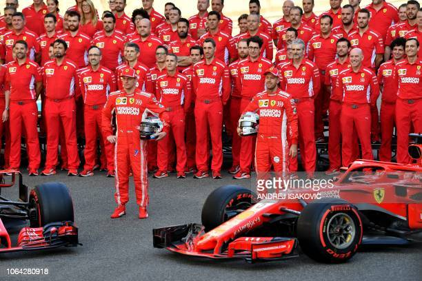 TOPSHOT Ferrari's F1 Team poses for a group picture ahead of the Abu Dhabi Formula One Grand Prix at the Yas Marina circuit on November 22 2018