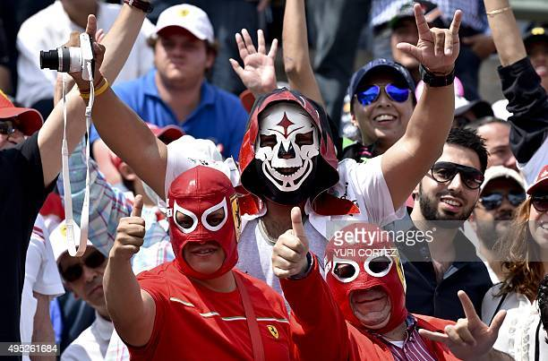 Ferrari's fans cheer before the start of the F1 Mexico Grand Prix at the Hermanos Rodriguez racetrack in Mexico City on November 1 2015 AFP PHOTO/...