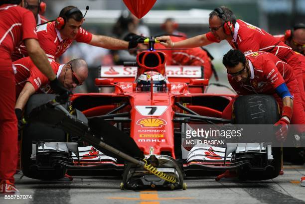 Ferrari's Finland driver Kimi Raikkonen returns to the pit lane during the third practice session of the Formula One Malaysia Grand Prix in Sepang on...