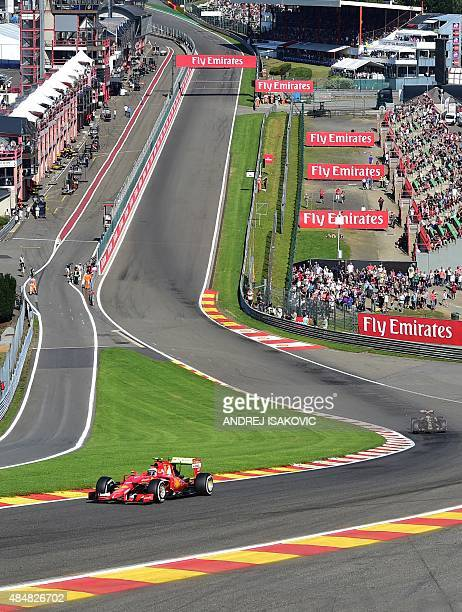 Ferrari's Finnish driver Kimi Raikkonen and Lotus F1 Team's French driver Romain Grosjean drive during the third practice session at the...