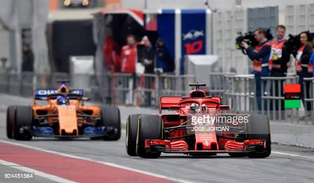 Ferrari's Finnish driver Kimi Raikkonen and McLaren's Spanish driver Fernando Alonso drive at the Circuit de Catalunya on February 26 2018 in...