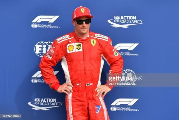 Ferrari's Finnish driver Kimi Raikkonen celebrates winning the pole position after the qualifying session at the Autodromo Nazionale circuit in Monza...