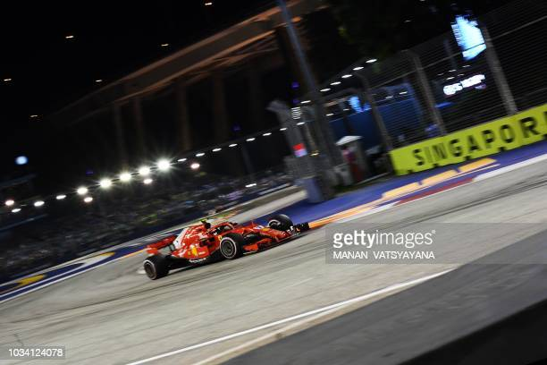 Ferrari's Finnish driver Kimi Raikkonen competes during Singapore Formula One Grand Prix at the Marina Bay Street Circuit in Singapore on September...