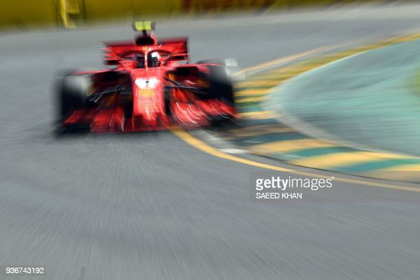 Ferrari's Finnish driver Kimi Raikkonen drives around the Albert Park circuit during the first Formula One practice session in Melbourne on March 23...