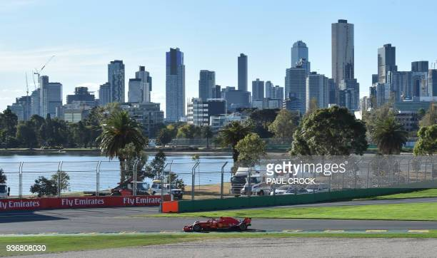 TOPSHOT Ferrari's Finnish driver Kimi Raikkonen drives around the Albert Park circuit during the second Formula One practice session in Melbourne on...