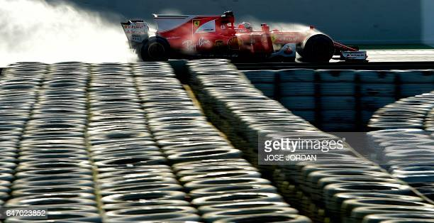 TOPSHOT Ferrari's Finnish driver Kimi Raikkonen drives at the Circuit de Catalunya on March 2 2017 in Montmelo on the outskirts of Barcelona during...