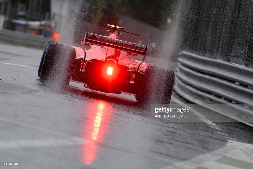 TOPSHOT - Ferrari's Finnish driver Kimi Raikkonen drives on a wet circuit during the third practice session at the Autodromo Nazionale circuit in Monza on September 2, 2017 ahead of the Italian Formula One Grand Prix. The start of the third practice session had been delayed due to heavy rain. /