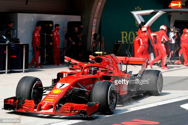 Ferrari's Finnish driver Kimi Raikkonen drives out of the pit stop during the Formula One Chinese Grand Prix in Shanghai on April 15 2018 / AFP PHOTO...