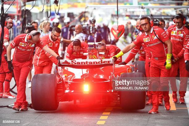 TOPSHOT Ferrari's Finnish driver Kimi Raikkonen prepares to leave the pits for the second practice session at the SpaFrancorchamps circuit in Spa on...