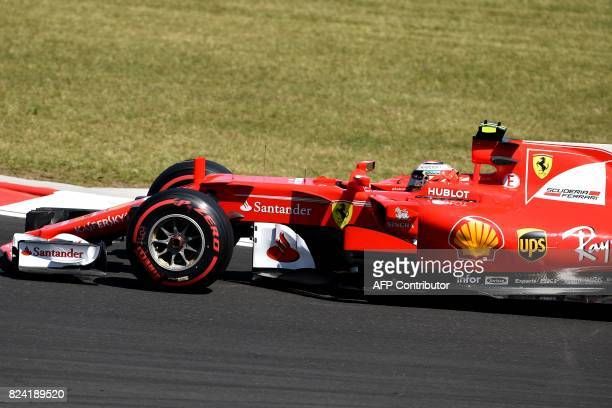 Ferrari's Finnish driver Kimi Raikkonen races during a free practice session at the Hungaroring racing circuit in Budapest on July 29 2017 prior to...