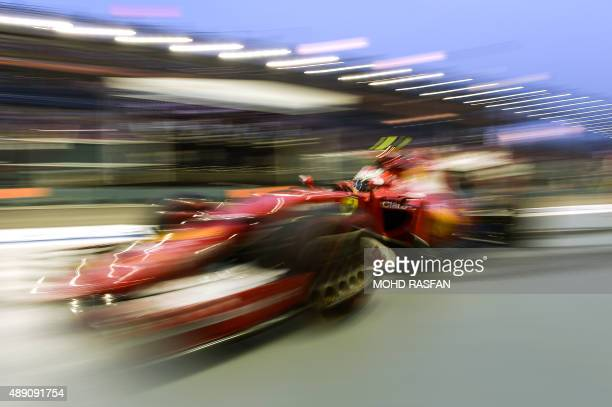 Ferrari's Finnish driver Kimi Raikkonen returns to pit lane during the third free practice session ahead of the Formula One Singapore Grand Prix in...
