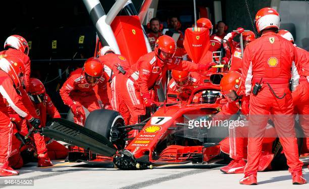 Ferrari's Finnish driver Kimi Raikkonen sits in his car at the pit stop during the Formula One Chinese Grand Prix in Shanghai on April 15 2018 / AFP...