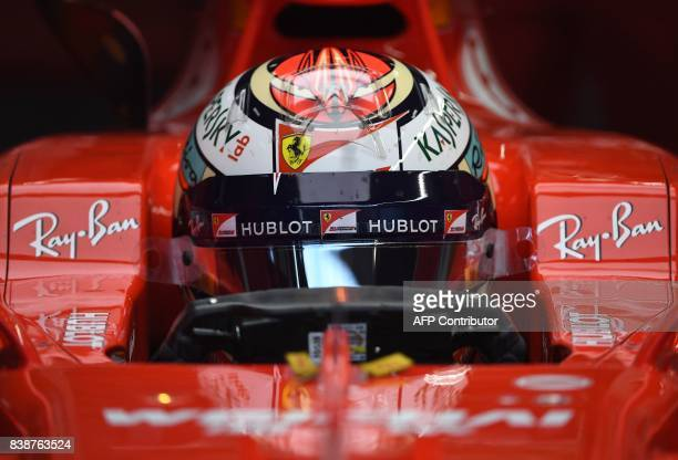 Ferrari's Finnish driver Kimi Raikkonen sits in his car in the pits during the first practice session at the SpaFrancorchamps circuit in Spa on...