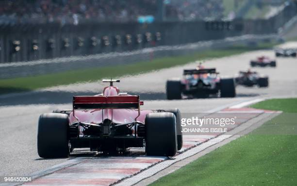 Ferrari's Finnish driver Kimi Raikkonen steers his car during the Formula One Chinese Grand Prix in Shanghai on April 15 2018 / AFP PHOTO / Johannes...