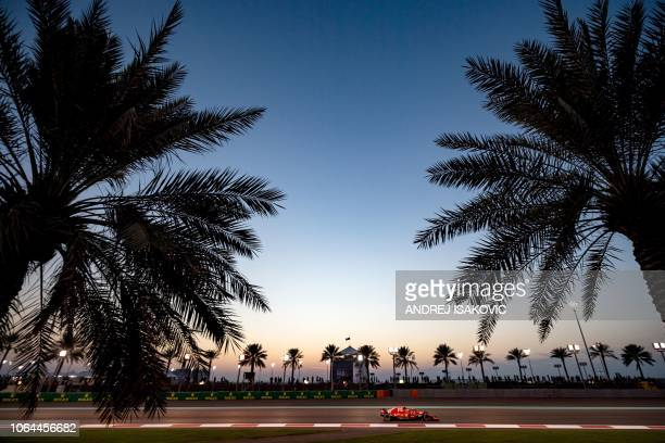 Ferrari's Finnish driver Kimi Raikkonen steers his car during the second practice session at the Yas Marina circuit on November 23 in Abu Dhabi,...