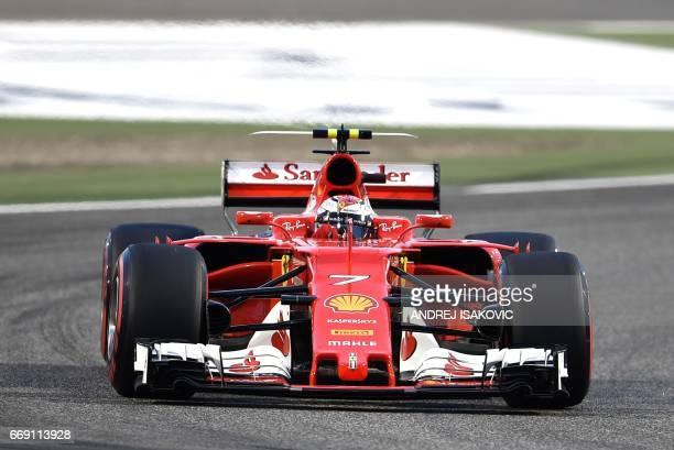 Ferrari's Finnish driver Kimi Raikkonen steers his car during the Bahrain Formula One Grand Prix at the Sakhir circuit in Manama on April 16 2017 /...