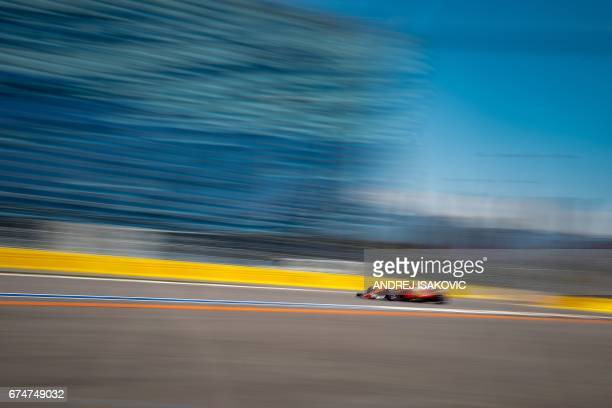 Ferrari's Finnish driver Kimi Raikkonen steers his car during the third practice session of the Formula One Russian Grand Prix at the Sochi Autodrom...