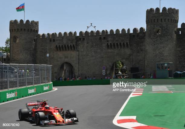 Ferrari's Finnish driver Kimi Raikkonen steers his car during the first practice session of the Formula One Azerbaijan Grand Prix at the Baku City...