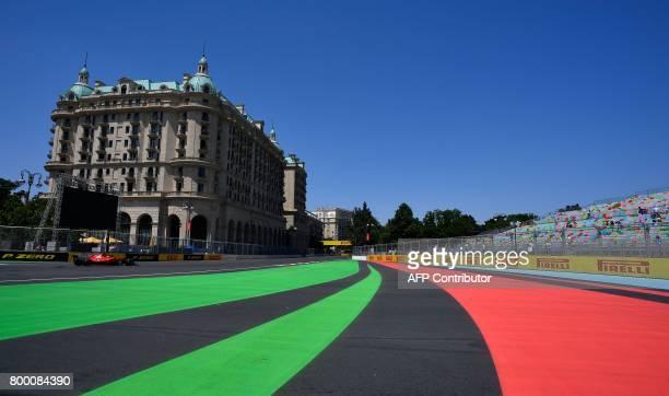 Ferrari's Finnish driver Kimi Raikkonen steers his car during the first practice session of the Formula One Azerbaijan Grand Prix at the Baku City...