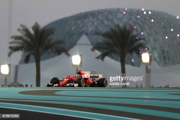 Ferrari's Finnish driver Kimi Raikkonen steers his car during the qualifying session ahead of the Abu Dhabi Formula One Grand Prix at the Yas Marina...