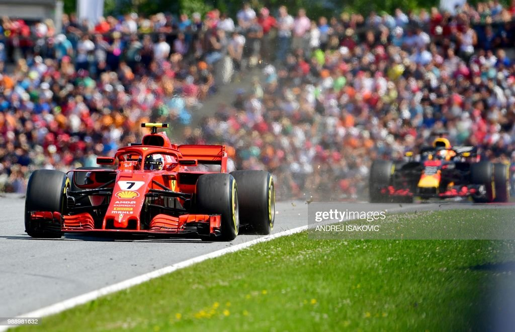 TOPSHOT - Ferrari's Finnish driver Kimi Raikkonen steers his car during the Austrian Formula One Grand Prix in Spielberg, central Austria, on July 1, 2018.