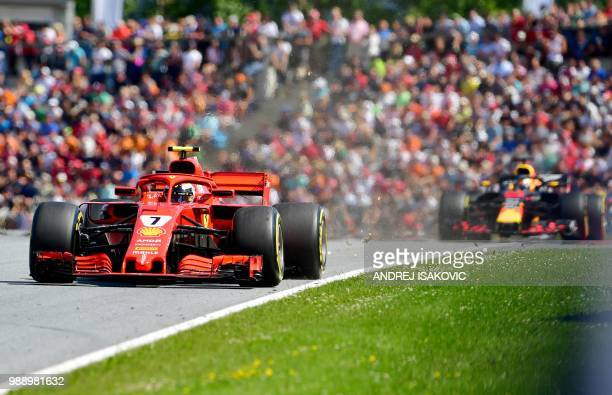 TOPSHOT Ferrari's Finnish driver Kimi Raikkonen steers his car during the Austrian Formula One Grand Prix in Spielberg central Austria on July 1 2018