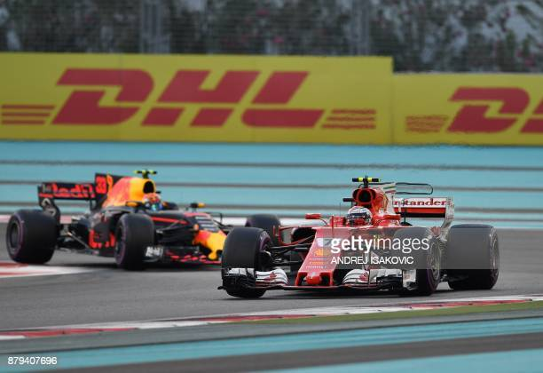 Ferrari's Finnish driver Kimi Raikkonen steers his car followed by Red Bull's Dutch driver Max Verstappen during the Abu Dhabi Formula One Grand Prix...