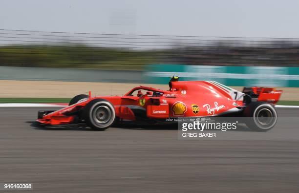 Ferrari's Finnish driver Kimi Raikkonen takes a corner during the Formula One Chinese Grand Prix in Shanghai on April 15 2018 / AFP PHOTO / GREG BAKER