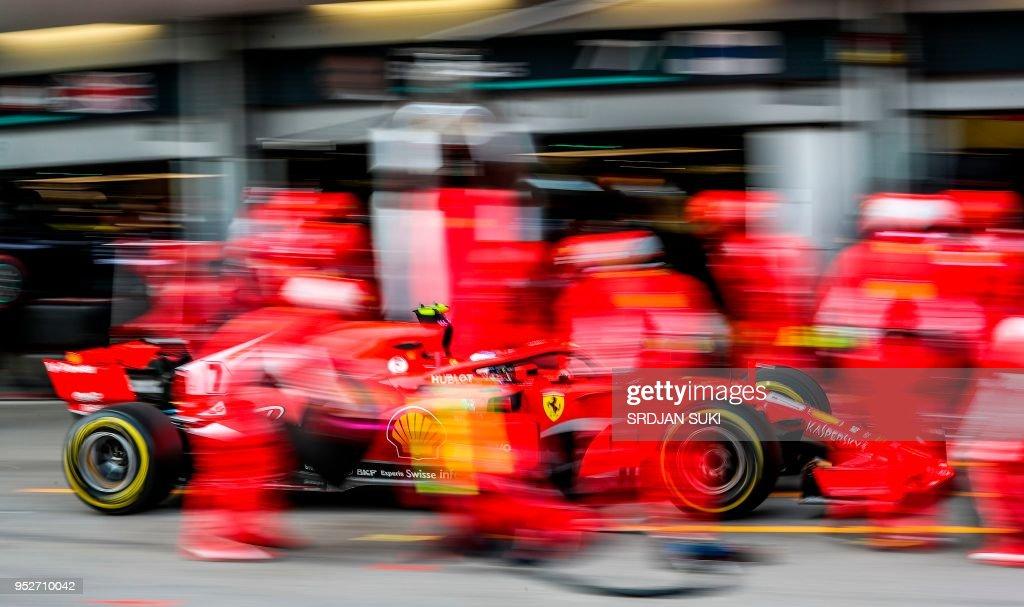 TOPSHOT - Ferrari's Finnish driver Kimi Raikkonen takes a pit stop during the Formula One Azerbaijan Grand Prix at the Baku City Circuit in Baku on April 29, 2018.