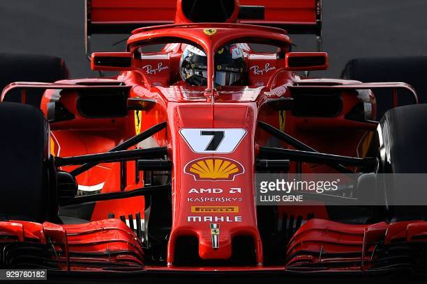 TOPSHOT Ferrari's Finnish driver Kimi Raikkonen takes part in the tests for the new Formula One Grand Prix season at the Circuit de Catalunya in...