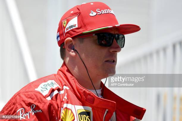 Ferrari's Finnish driver Kimi Raikkonen walks during the first practice session of the Formula One Azerbaijan Grand Prix at the Baku City Circuit on...