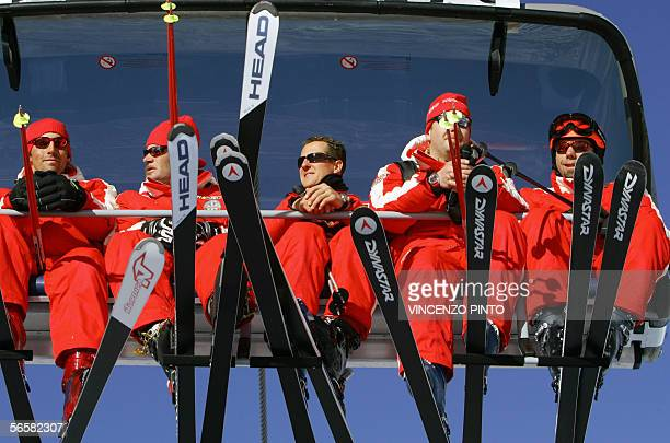 Ferrari's Formula One drivers Michael Schumacher of Germany arrives with ski teachers for a giant slalom race 13 January 2006 during an annual...
