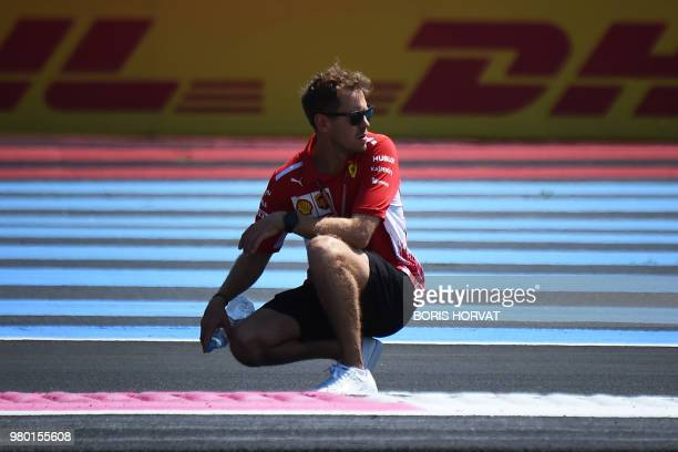 TOPSHOT Ferrari's German driver Sebastian Vettel and team inspect the Circuit Paul Ricard in Le Castellet southern France on June 21 a few days ahead...
