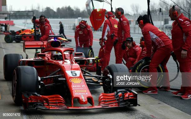 Ferrari's German driver Sebastian Vettel arrives in the pits at the Circuit de Catalunya on February 27 2018 in Montmelo on the outskirts of...