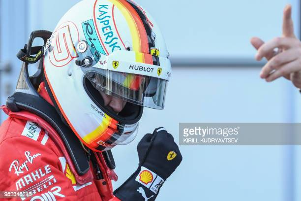 Ferrari's German driver Sebastian Vettel celebrates his pole position following the qualifying session for the Formula One Azerbaijan Grand Prix at...