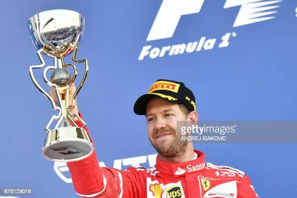 Ferrari's German driver Sebastian Vettel celebrates his second place after the Formula One Russian Grand Prix at the Sochi Autodrom circuit in Sochi...