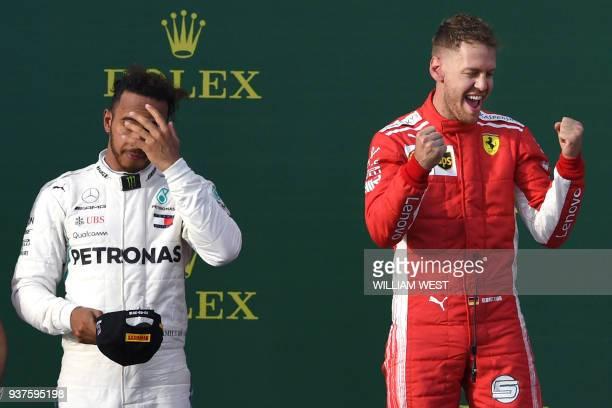 TOPSHOT Ferrari's German driver Sebastian Vettel celebrates winning the Formula One Australian Grand Prix beside secondplaced Mercedes' British...