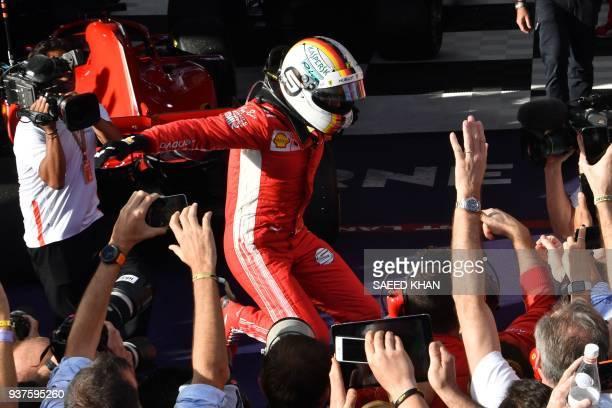 TOPSHOT Ferrari's German driver Sebastian Vettel celebrates winning the Formula One Australian Grand Prix in Melbourne on March 25 2018 / AFP PHOTO /...