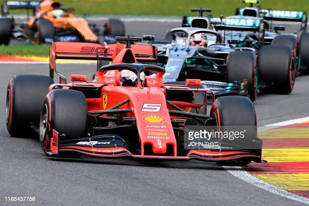 Ferrari's German driver Sebastian Vettel competes ahead of Mercedes' British driver Lewis Hamilton and Mercedes' Finnish driver Valtteri Bottas...