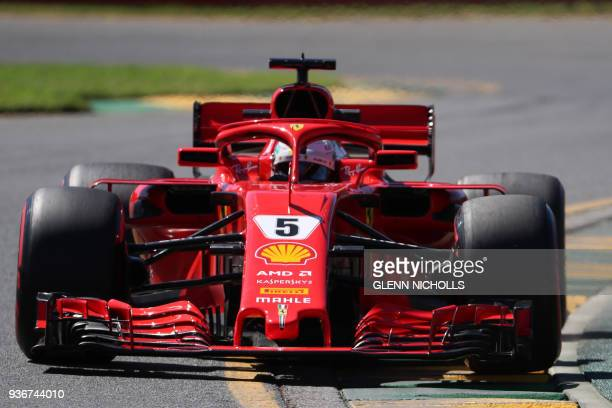 Ferrari's German driver Sebastian Vettel drives around the Albert Park circuit during the first Formula One practice session in Melbourne on March 23...
