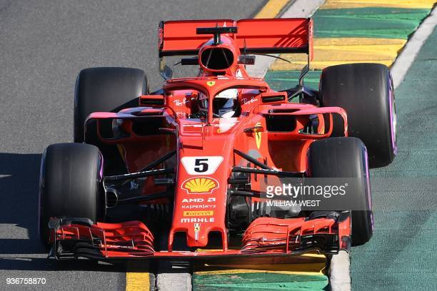 Ferrari's German driver Sebastian Vettel drives around the Albert Park circuit during the second Formula One practice session in Melbourne on March...