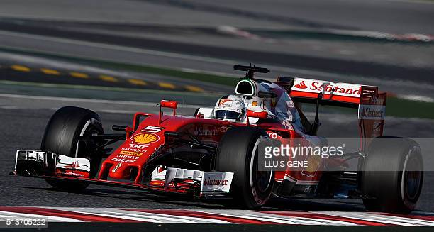 Ferrari's German driver Sebastian Vettel drives at the Circuit de Catalunya on March 4 2016 in Montmelo on the outskirts of Barcelona during the...