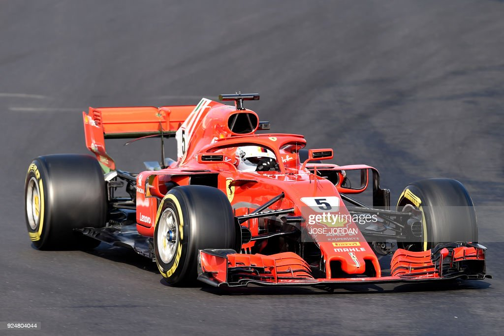 Ferrari's German driver Sebastian Vettel drives at the Circuit de Catalunya on February 27, 2018 in Montmelo on the outskirts of Barcelona during the second day of the first week of tests for the Formula One Grand Prix season. /
